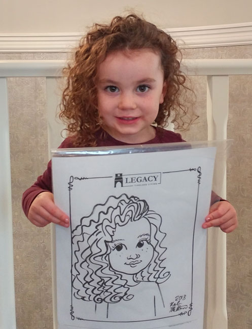 Cute curly haired girl with her caricature.