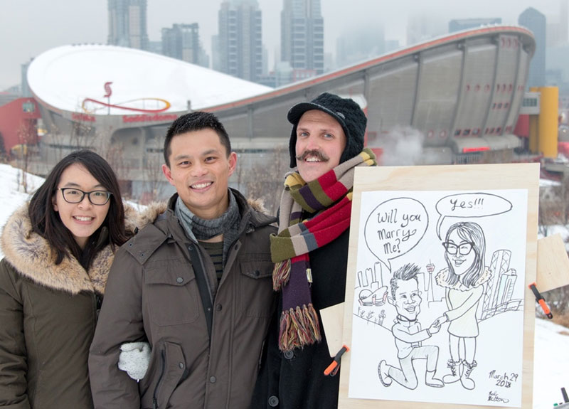 Engaged Couple with their proposal caricature and artist.