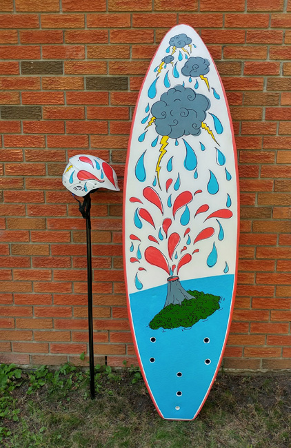 Surfboard and matching helmet with illustration of exploding volcano and storming clouds.